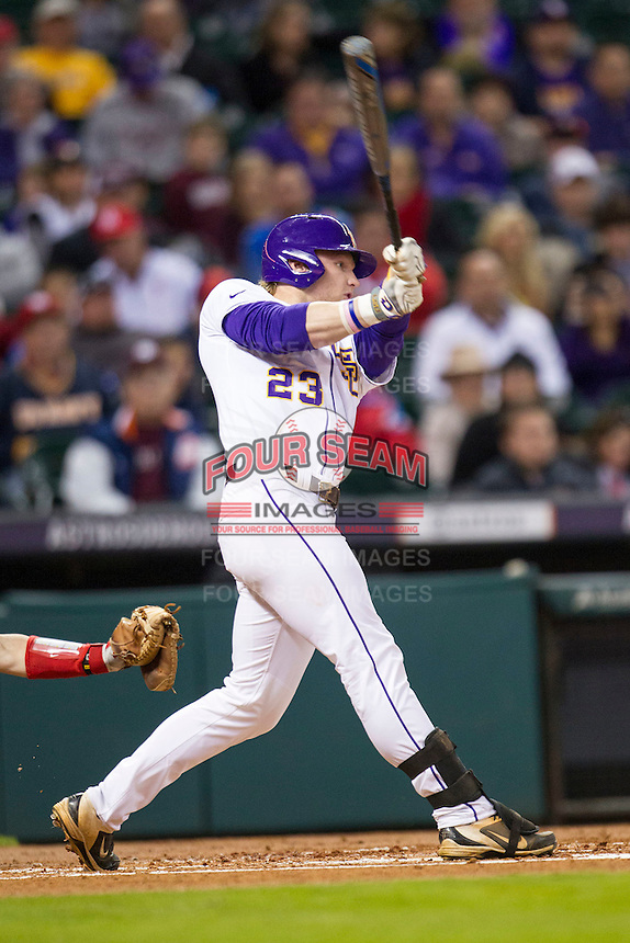 LSU Tigers outfielder Jake Fraley (23) swings the bat during the NCAA baseball game against the Houston Cougars on March 6, 2015 at Minute Maid Park in Houston, Texas. LSU defeated Houston 4-2. (Andrew Woolley/Four Seam Images)