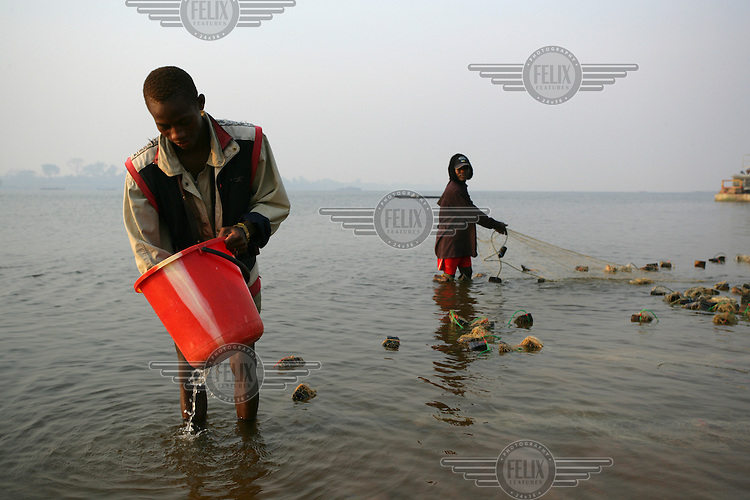 Fishermen working in the shallows.