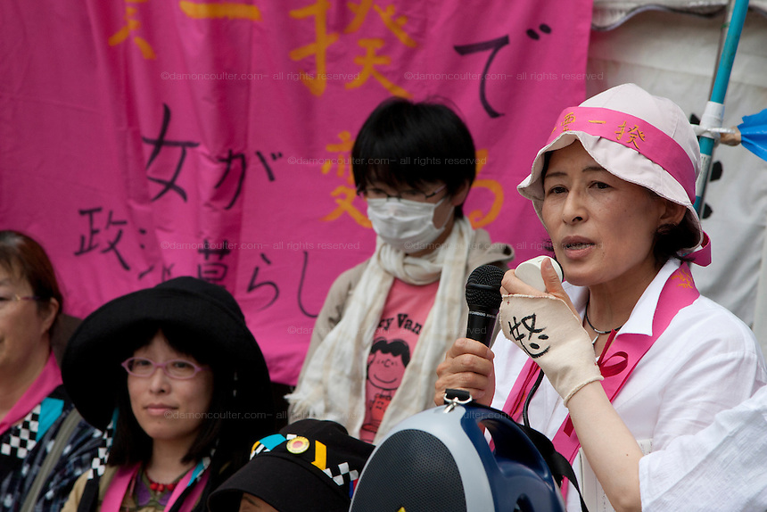 Yuko Yatabe one of the organizers of the Anti nuclear protest by women outside METI (Ministry of Economy, Trade and Industry) in Tokyo, Japan. Friday June 29th 2012. About 400 protesters campaigned the restarting of the Oi nuclear power-station and the policy of Prime-Minister Noda to restart Japan's nuclear power generation programme which has been stalled since the earthquake and tsunami of March 11th 2011 caused meltdown and radiation leaks at the Fukushima Daichi Nuclear power-plant.
