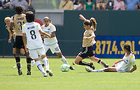 FC Gold Pride's Tina Di Martino is tripped by LA  Sol's Shannon Boxx. The LA Sol defeated FC Gold Pride of the Bay Area 1-0 at Home Depot Center stadium in Carson, California on Sunday April 19, 2009.  .
