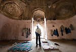 Security guard Avanish Yadav  who currently lives inside the Bara Lao Ka Gumbad  tomb at Basant Lok in Delhi, India. Squatters have recently been evicted after living there since 1943 and the surrounding homes bulldozed. Yadav keeps the former residents from returning. The occupants had painted the walls pink and erected large steel doors on the entrances. The Archaeological Survey of India has been on a campaign to evict people who have illegally made the tombs their homes throughout the city in recent times but is facing stiff opposition from the residents.