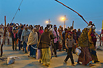 Pilgrims arriving to take a holy bath in the Ganges River in Allahabad for Kumbh Mela Festival.