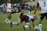 San Jose Earthquakes midfielder Bobby Convey (11) mid-air against Colorado Rapids midfielder Brian Mullan (11)  during the Colorado Rapids 2-1 victory over the San Jose Earthquakes at Buck Shaw Stadium in Santa Clara, California.
