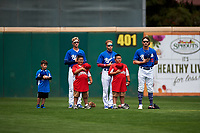 Rancho Cucamonga Quakes outfielders Logan Landon (6), Jeren Kendall (3), and Donovan Casey (19) stand alongside Little League baseball players during the National Anthem before a California League game against the Lake Elsinore Storm at LoanMart Field on May 20, 2018 in Rancho Cucamonga, California. Rancho Cucamonga defeated Lake Elsinore 6-2. (Zachary Lucy/Four Seam Images)