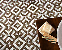Laberinto Grand, a handmade mosaic shown in polished Calacatta and Bayard, is part of the Parterre Collection by Paul Schatz for New Ravenna.