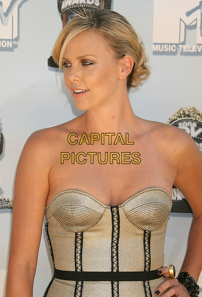CHARLIZE THERON .Arrivals - 2008 MTV Movie Awards held at Gibson Amphitheatre, Universal City, California, USA, 01 June 2008..portrait headshot strapless gold corset.CAP/ADM/MJ.©Michael Jade/Admedia/Capital Pictures