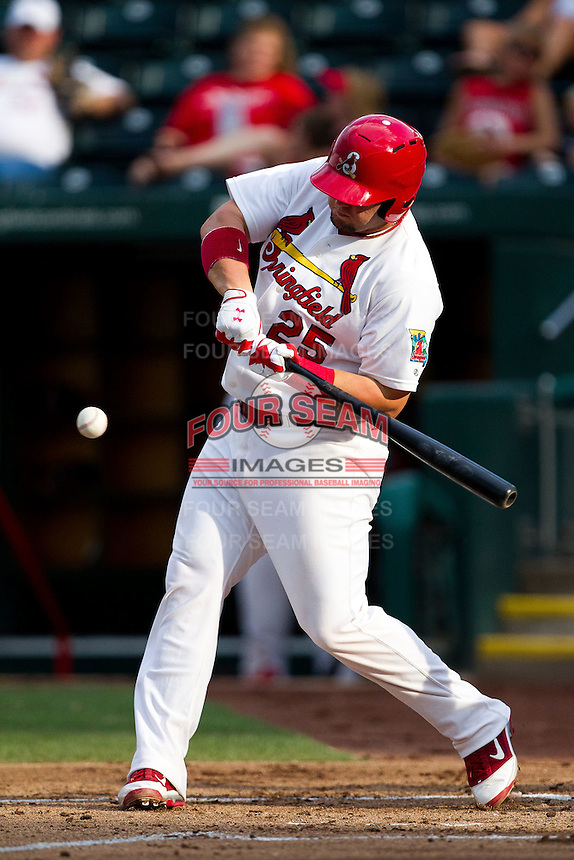 Matt Adams (25) of the Springfield Cardinals tries to make contact on a pitch during a game against the Northwest Arkansas Naturals at Hammons Field on July 31, 2011 in Springfield, Missouri. Northwest Arkansas defeated Springfield 9-1. (David Welker / Four Seam Images)