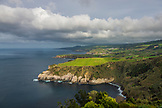 PORTUGAL, The Azores, Sao Miguel Island, View of green hills and the Atlantic Ocean