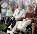 (Framingham 051913)  Ron and Karen Brassard, react to the standing ovation,  Sunday during the commencement ceremony at Framingham State University. The Brassard's were at the graduation for Robert Wheeler who offered aid to Ron Brassard of the day of the bombing.  (Jim Michaud Photo)