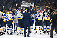 June 12, 2019: St. Louis Blues head coach Craig Berube celebrates with the Stanley Cup at game 7 of the NHL Stanley Cup Finals between the St Louis Blues and the Boston Bruins held at TD Garden, in Boston, Mass.  The Saint Louis Blues defeat the Boston Bruins 4-1 in game 7 to win the 2019 Stanley Cup Championship.  Eric Canha/CSM.
