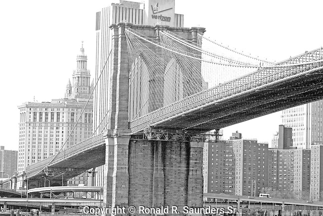 Brooklyn Bridge (suspension bridge spanning East River between New York City boroughs of Brooklyn and Manhattan) - Built between 1869 and 1883
