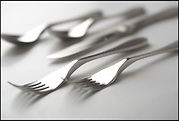 BNPS.co.uk (01202 558833)<br /> Pic: BNPS<br /> <br /> A brand new piece of cutlery has been invented to save on the washing up - a knife and fork in one.<br /> <br /> The wacky contraption, dubbed the 'Knork', combines the four prongs of a fork with the sharp edge of a knife.<br /> <br /> The stainless steel device has been cleverly made with very slight curved edges, so the bladed section will not cut someone as it is used.<br /> <br /> The Knork can be used on a variety of food such as chicken, pizza, fish, vegetables, salad, and even tender steak.<br /> <br /> It is ideal for picnics and barbeques as it will reduce the amount of cutlery required by half, and could save on washing up when used at home.<br /> <br /> The gadget can be used by all age groups and can even help disabled people who may be restricted to using just one hand to eat.<br /> <br /> The Knork costs 19.50 pounds for a pack of five or 53.62 pounds for a pack of 20.<br /> <br /> Simon Buckingham, 53, marketing director at Buckingham Healthcare in Poole, Dorset, said: &quot;The Knork is a knife and fork in one.
