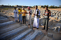 Rebel fighters, gathered in Misurata's cemetery, mourn at the grave of one of their comrades who was killed during the siege of Misurata in April 2011. In February 2011 an armed revolution broke out in Libya and after six months of fighting it appears that Gaddafi's 42 year regime has come to an end while the former dictator is currently on the run....