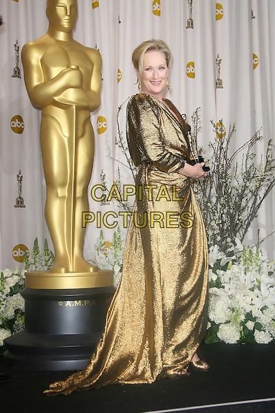 Meryl Streep.84th Annual Academy Awards held at the Hollywood & Highland Center, Hollywood, California, USA..February 26th, 2012.oscars full length gold dress award trophy winner side  .CAP/ADM.©AdMedia/Capital Pictures.