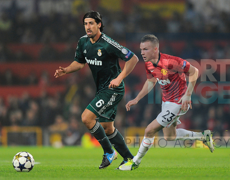 Sami Khedira of Real Madrid and Tom Cleverley of Manchester United - UEFA CHAMPIONS LEAGUE - ROUND OF 16  - Manchester Utd vs Real Madrid - Old Trafford Stadium - Manchester - 05/03/13 - Picture Simon Bellis/Sportimage-