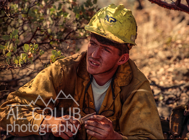 September 15, 1990 Tuolumne City, California -- Cottonwood Fire -- US Forest Service sawyer takes a break under a manzanita bush. The Cottonwood Fire was held to 2,000 acres by the fast action of fire crews.  The fire threatened several small communities. The big challenge was to make sure the fire didn't get past the Hacienda fuel break, keeping the fire out of the Tuolumne River.