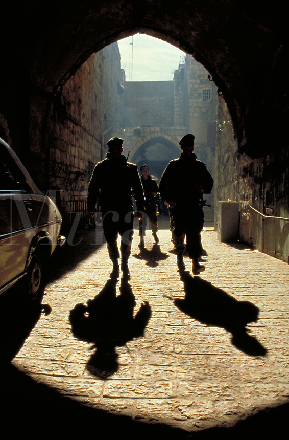 TITLE - DISTANT RELATIONS, ISRAELI ARMY PATROLS THE STREETS OF JERUSALEM,. JERUSALEM ISRAEL.