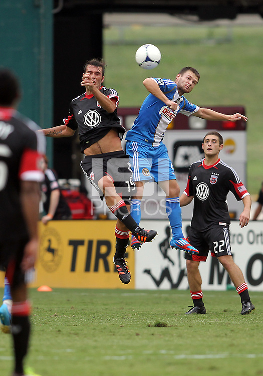 WASHINGTON, D.C. - AUGUST 19, 2012:  Emilliano Dudar (19) of DC United and Jack McInerney (9) of the Philadelphia Union up for a high ball during an MLS match at RFK Stadium, in Washington DC, on August 19. The game ended in a 1-1 tie.
