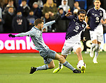 Ilie Sanchez (L) of Sporting KC vies for the ball with Rodolfo Pizarro of C.F Monterrey during their CONCACAF Champions League semifinal soccer game on April 11, 2019 at Children's Mercy Park in Kansas City, Kansas.  Photo by TIM VIZER/AFP