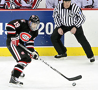 St. Cloud State's Drew LeBlanc looks to control the puck. UNO beat St. Cloud State 3-0 Friday night at Qwest Center Omaha.  (Photo by Michelle Bishop)