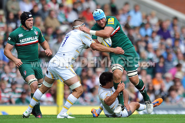 Jordan Crane is tackled in possession. Aviva Premiership match, between Leicester Tigers and Worcester Warriors on September 8, 2013 at Welford Road in Leicester, England. Photo by: Patrick Khachfe / JMP
