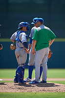Lexington Legends pitching coach Mitch Stetter (32) talks with starting pitcher Jonathan Bowlan (35) and catcher Freddy Fermin (4) during a South Atlantic League game against the Augusta GreenJackets on April 30, 2019 at SRP Park in Augusta, Georgia.  Augusta defeated Lexington 5-1.  (Mike Janes/Four Seam Images)