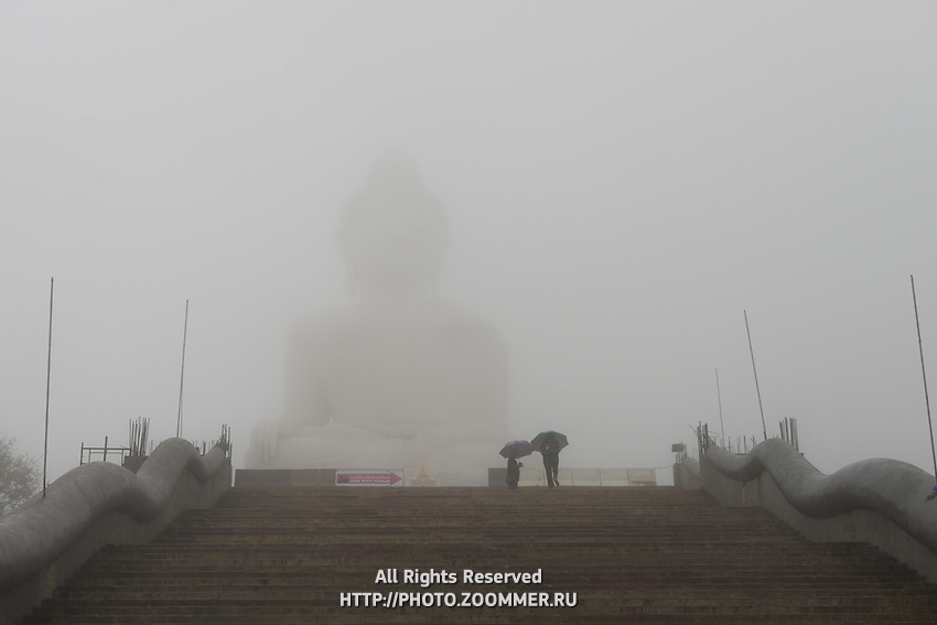 The Big Buddha monumet during rain on Phuket, Thailand