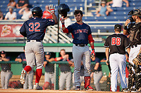 Lowell Spinners Gilberto Jimenez (32) is greeted at home plate by Jaxx Groshans (12) after hitting a home run during a NY-Penn League game against the Batavia Muckdogs on July 10, 2019 at Dwyer Stadium in Batavia, New York.  Batavia defeated Lowell 8-6.  (Mike Janes/Four Seam Images)