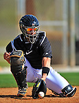 13 March 2012: Miami Marlins catcher John Buck warms up prior to a Spring Training game against the Atlanta Braves at Roger Dean Stadium in Jupiter, Florida. The two teams battled to a 2-2 tie playing 10 innings of Grapefruit League action. Mandatory Credit: Ed Wolfstein Photo