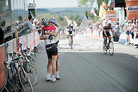 race winner Pauline Ferrand Prevot (FRA/Rabobank-Liv) hugging teammate/world champion/legend Marianne Vos (NLD/Rabobank-Liv) just accross the finish line<br /> <br /> La Flèche Wallonne 2014