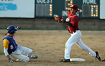 SIOUX FALLS, SD - MAY 26:  Jaden Holser #8 from O'Gorman slides into second as Connor Grove #1 from Roosevelt looks to turn a double play in the third inning during the Class A Championship Game Saturday night at the Sioux Falls Stadium. (Photo by Dave Eggen/Inertia)