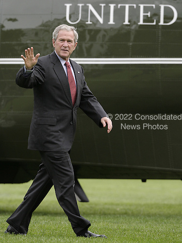 United States President George W. Bush waves as he walks past the Marine One helicopter upon his return to the White House in Washington, DC on September 16, 2008 after taking a tour of the damage from Hurricane Ike in Texas. <br /> Credit: Yuri Gripas / Pool via CNP