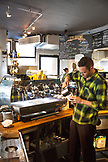 USA, Colorado, Aspen, pouring coffee at Victoria's Espresso Wine Bar, downtown Aspen
