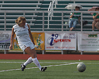Boston Aztec midfielder/defender Alex Bengston (9) passes the ball.  In a Women's Premier Soccer League (WPSL) match, Boston Aztec (white) defeated Seacoast United Mariners (blue), 2-1, at North Reading High School Stadium on Arthur J. Kenney Athletic Field on on June 23, 2013. Due to injuries through the season, Seacoast United Mariners could only field 10 players.