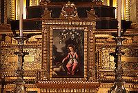 Painting on an altar in the Jesuit Church of Saints Justus and Pastor of Alcala, built 1575 on the site of a mosque in Granada, Andalusia, Southern Spain. The painting is possibly of the Christ child as the good shepherd. Saints Justus and Pastor were 4th century schoolboy christian martyrs, who were killed for their faith under the persecution of the christians by the Roman emperor Diocletian. Granada was listed as a UNESCO World Heritage Site in 1984. Picture by Manuel Cohen