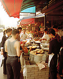 CHINA, Hangzhou, people standing by foodstall at a marketplace