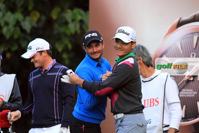Gareth Maybin (NIR)with Timothy Tang (HKG) after he  had a hole in one on the 4th on Day 2 of the UBS Hong Kong Open 2011...Photo GOLFFILE/Jenny Matthews.(Photo credit should read Jenny Matthews/GOLFFILE)