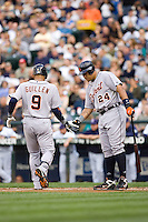 July 5, 2008:  The Detroit Tigers' Miguel Cabrera (24) gives teammate Carlos Guillen (9) a hand of approval as Guillen crosses home plate after connecting for a first inning solo home run off Seattle Mariners starter R.A. Dickey.
