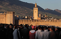 People on Boujloud Square with the 13th century city walls behind, in the medina of Fes, Fes-Boulemane, Northern Morocco. The medina of Fes was listed as a UNESCO World Heritage Site in 1981. Picture by Manuel Cohen