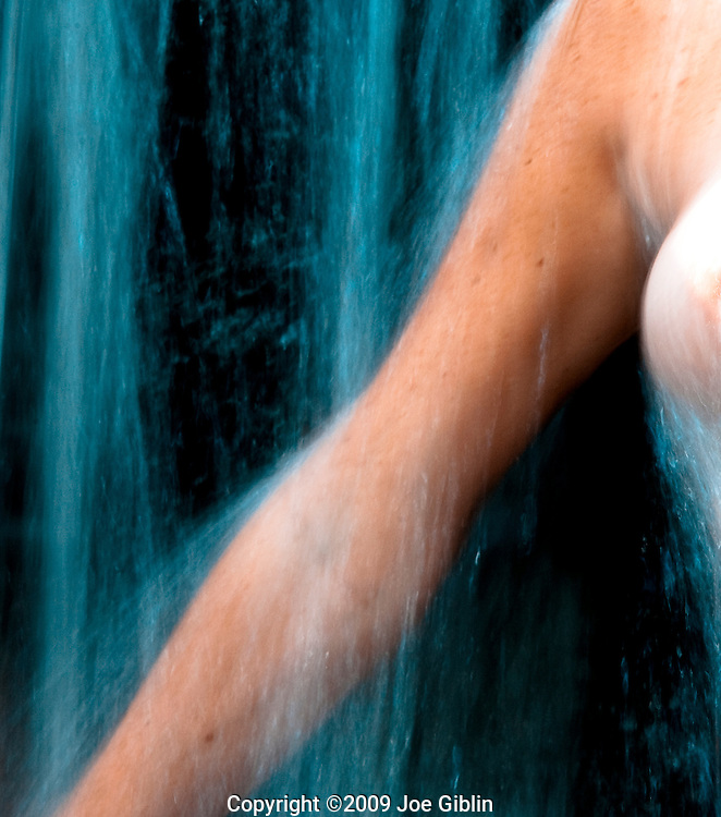 Female Form in Waterfall, arm and portion of breast, implying nudity, non-graphic. Model Release Available