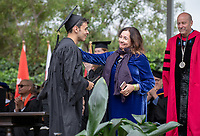 Raphael Gonzalez & Denise Frost<br /> Families, friends, faculty, staff and distinguished guests celebrate the class of 2019 during Occidental College's 137th Commencement ceremony on Sunday, May 19, 2019 in the Remsen Bird Hillside Theater.<br /> (Photo by Marc Campos, Occidental College Photographer)