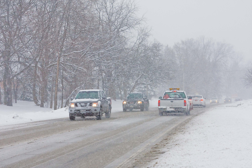 Images showing a heavy snowfall in a typical suburban subdivision. These include cars navigating dangerously slippery rural roads.