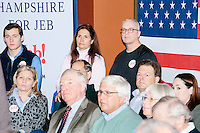 People listen as Republican presidential candidate and former Florida governor Jeb Bush speaks at a town hall in Souhegan High School in Amherst, New Hampshire.