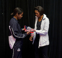 First Lady Michelle Obama stands with Briana Scurry, goalkeeper for the Washington Freedom, during a US Soccer Foundation clinic held at City Center in Washington, DC.