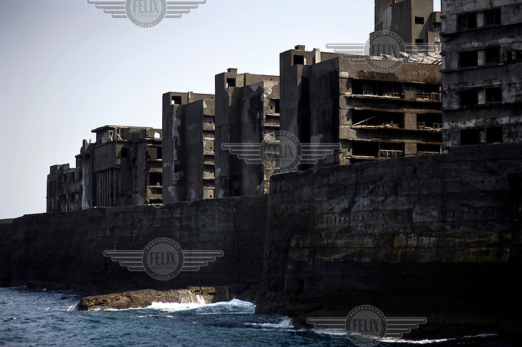Concrete structures on Hashima Island, nicknamed Gunkanjima or Battleship Island as it resembles a massive battleship. It is now an abandoned cluster of buildings rising from the Pacific ocean. From 1887 until 1974, the small island was a coal mine for the Mitsubishi Mining Company with 5259 residents, resulting as the highest population density in ever recorded worldwide. In 1974, the mine was closed, and its residents had to leave Gunkanjima, abandoning the island with all its buildings. The island was a location for the James Bond film Skyfall. /Felix Features