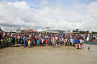 People and relatives stands in the bank of river Padma.  The Pinak-6, a passenger vessel sank in the middle of the river Padma on its way to Mawa from Kawrakandi terminal at around 11 PM today. The boat capsized since the river was rough due to the stormy weather. At least 250 people were in the capsized boat. Local people rescued nearly 45 passengers from the river and many other are still missing. Stormy weather and strong current hamper the rescue operation. Mawa, Munshigonj, near Dhaka, Bangladesh