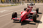USA, Indiana, Indianapolis Motor Speedway, ride in a street-legal version of an Indy 500 car at Dellara car manufacturing facility by journalist Lee Foster..