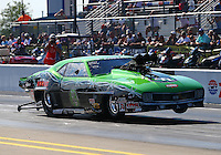 Sep 13, 2013; Charlotte, NC, USA; NHRA pro mod driver Eric Latino during qualifying for the Carolina Nationals at zMax Dragway. Mandatory Credit: Mark J. Rebilas-