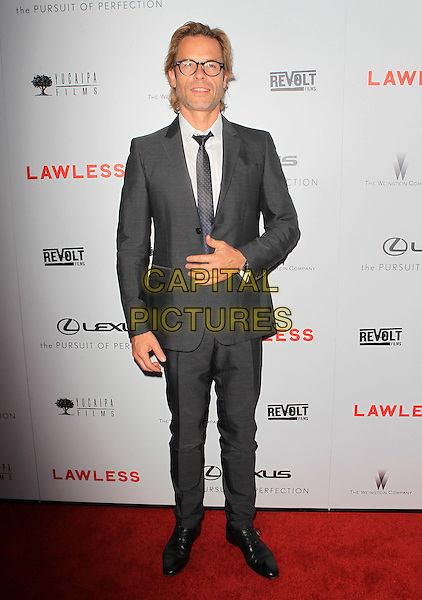 "Guy Pearce .""Lawless"" premiere held at ArcLight Cinemas, Hollywood, California, USA..August 22nd, 2012.full length suit white shirt tie grey gray glasses .CAP/ADM/KB.©Kevan Brooks/AdMedia/Capital Pictures."