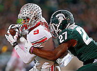 Ohio State Buckeyes wide receiver Devin Smith (9) makes a catch against Michigan State Spartans safety Kurtis Drummond (27) during the 1st quarter at Spartan Stadium in East Lansing, Michigan on November 8, 2014.  (Dispatch photo by Kyle Robertson)